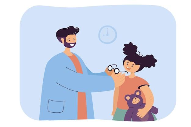 Oftalmologo che assiste nella selezione degli occhiali per il bambino