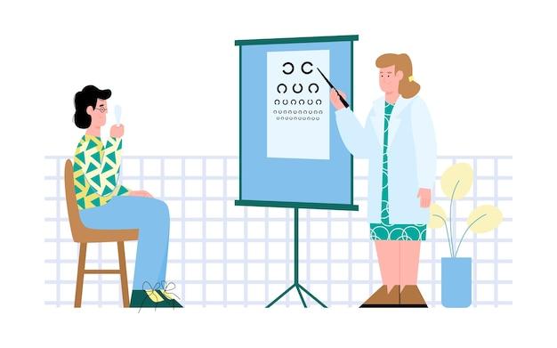 Офтальмолог или оптометрист, осматривающий пациента