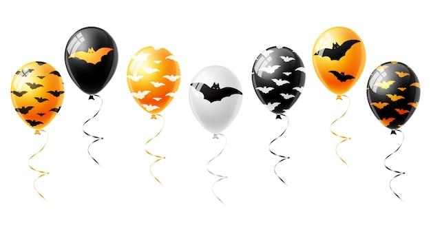 オレンジと黒の風船が白で隔離ハロウィーンの設定