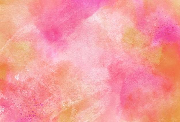 オレンジとピンクの水彩画の背景