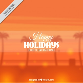 Orange background of palm trees with bokeh effect