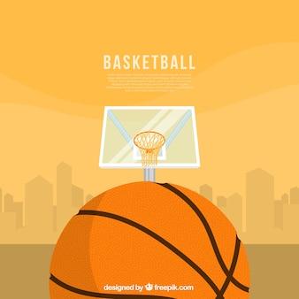 Sfondo arancione con cesto e palla da basket