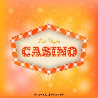 Orange background with light sign of casino