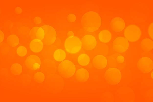 Orange bokeh lights background with text soace