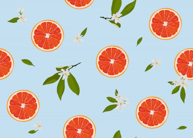 Orange fruits slice seamless pattern with flowers