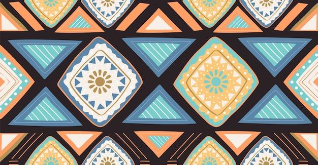 アフリカ風のオレンジグリーンブルー幾何学的シームレスパターン