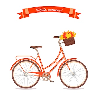 Orange retro bicycle with autumn leaves in floral basket.