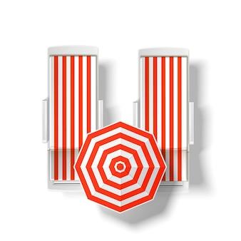 Orange striped sun umbrella near beach lounger