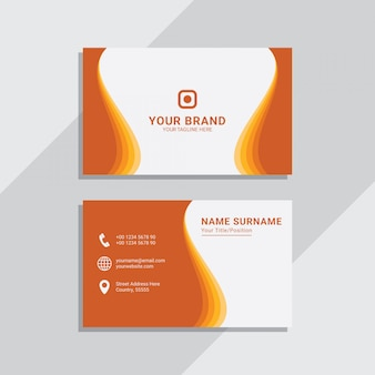 Orange wavy corporate business card template premium vector