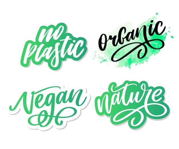 Органическая кисть надписи. нарисованное рукой слово органическое с зелеными листьями. метка, логотип шаблон для органических продуктов, рынков здоровой пищи.