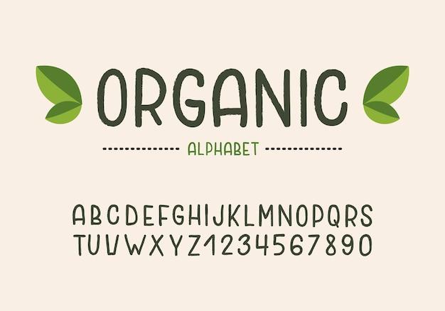 파스텔 배경에 고립 된 유기농 필기 알파벳