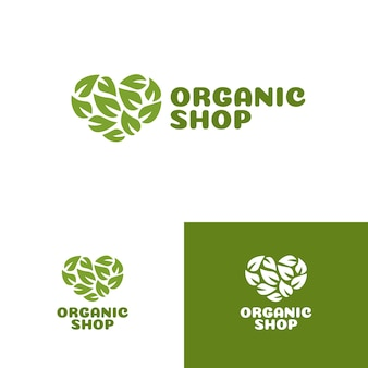 Логотип магазина органических продуктов с зеленым сердцем, состоящим из набора листьев