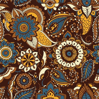 Oriental seamless pattern with ethnic buta motifs and persian floral mehndi elements on brown background
