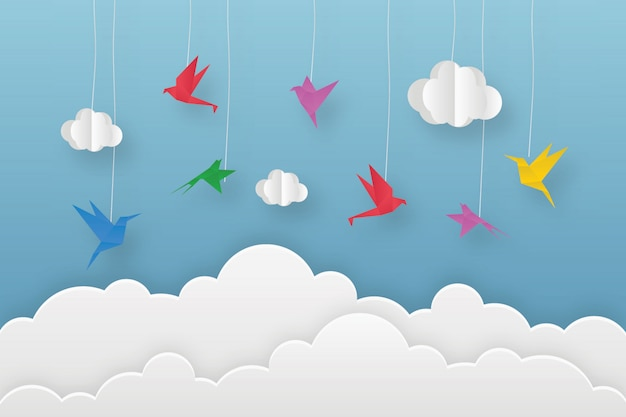 Origami colorful birds in clouds