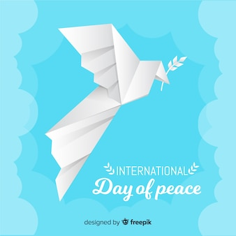Origami dove for peace day with olive leaf