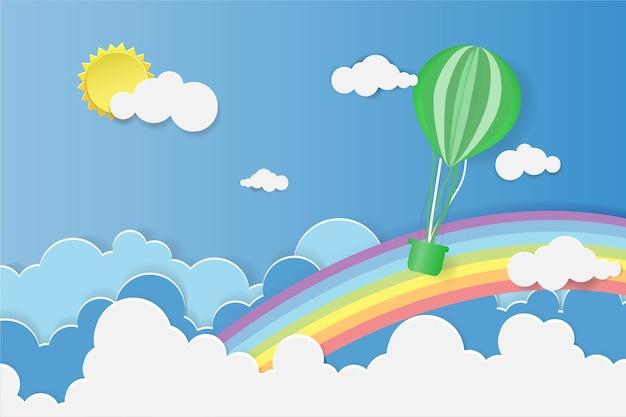 折り紙は虹で青空の上に風船を作った。