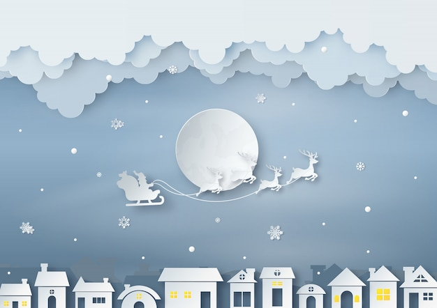 Origami made of santa claus rides reindeer sleigh
