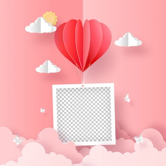 Origami paper art of blank photo with heart shape balloon on the sky