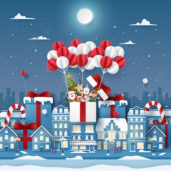 Origami paper art of cute christmas character on balloon in town with snowing