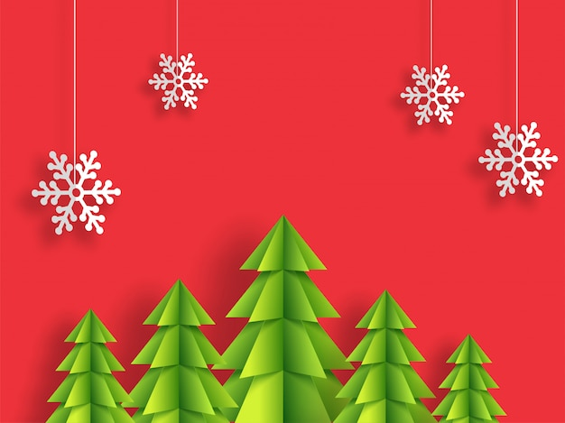 Origami paper xmas tree and hanging snowflakes decorated on red background