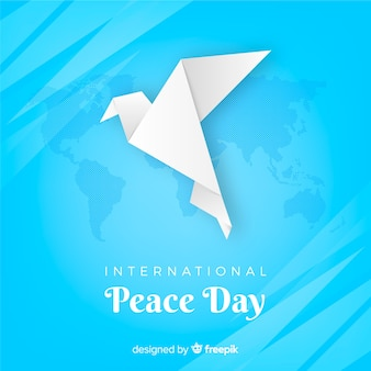Origami peace day background with a dove
