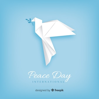 Origami peace day background with dove