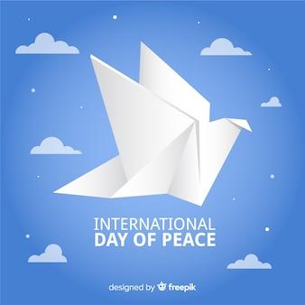 Origami peace day with dove and clouds