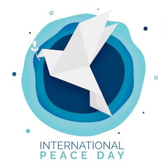 Оригами голубь с листа символом мира с абстрактным слоем bg