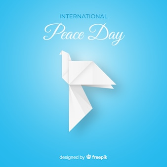 Origami white dove on blue background