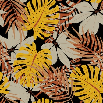 Original abstract seamless pattern with colorful tropical leaves and plants on black