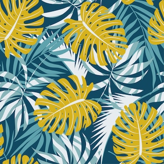 Original abstract seamless pattern with colorful tropical leaves and plants on blue background
