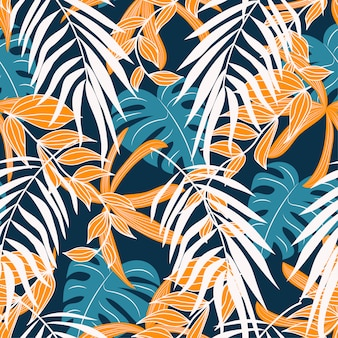 Original abstract seamless pattern with colorful tropical leaves and plants on a delicate background