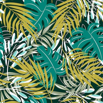 Original abstract seamless pattern with colorful tropical leaves and plants on green background