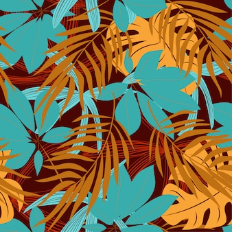 Original abstract seamless pattern with colorful tropical leaves and plants on red background
