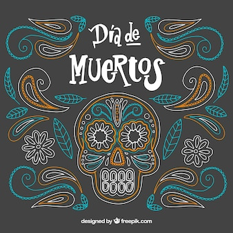 Ornamental day of the dead background with hand drawn skull