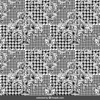 Ornamental flowers on houndstooth background