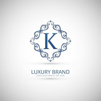 Ornamental letter k logo