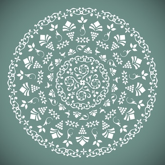 Ornamental round pattern with floral elements