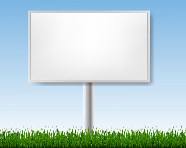 Outdoor advertising display with blue sky and grass