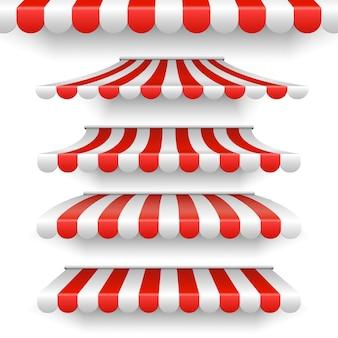 Наружные навесы. красные и белые полосатые зонтики на белом фоне