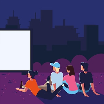 Outdoor cinema with people watching the screen