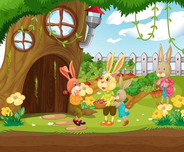 Scena all'aperto con felice famiglia di conigli in giardino