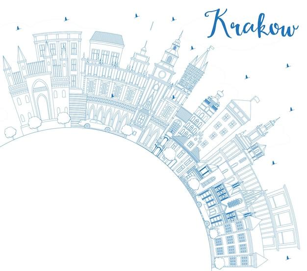Наброски на фоне линии горизонта города краков польша с синими зданиями и копией пространства. векторные иллюстрации. деловые поездки и концепция туризма с исторической архитектурой. городской пейзаж кракова с достопримечательностями.
