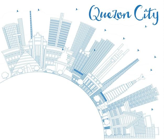 青い建物とコピースペースのあるケソンシティフィリピンのスカイラインの概要