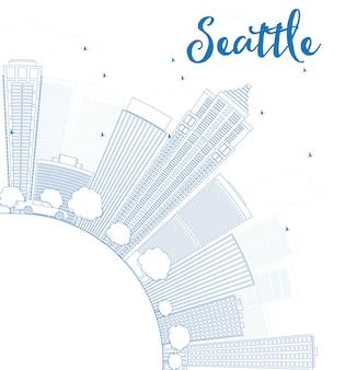 青い建物とコピースペースとシアトル市のスカイラインの概要