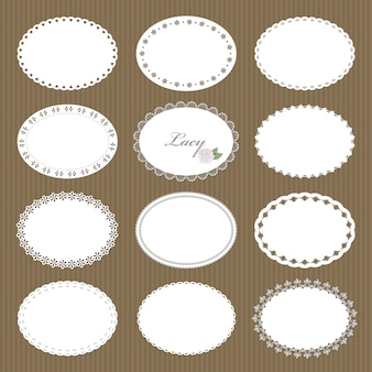 Oval lacy doilies big set on cardboard background