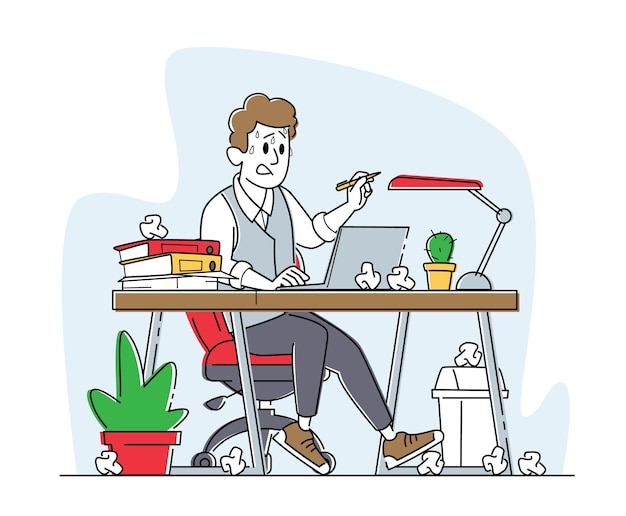 Overloaded stressed male office employee sitting at workplace with computer and heap of documents and crumpled papers