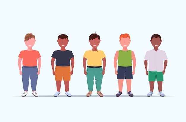 Overweight smiling boys over size children group standing together unhealthy lifestyle concept  mix  male kids full length flat white background horizontal
