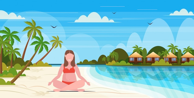 Overweight woman in swimsuit plus size girl on beach sitting lotus pose summer vacation obesity concept tropical island seascape background full length flat horizontal