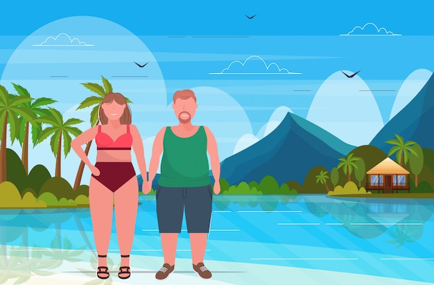 Overweight woman in swimsuit with  man plus size couple standing together summer vacation concept tropical island seascape background full length flat horizontal